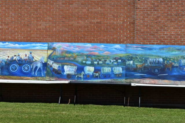 Photo of mural of historic Mule Train procession