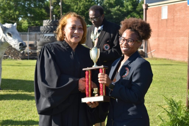 Photo of two women holding trophy