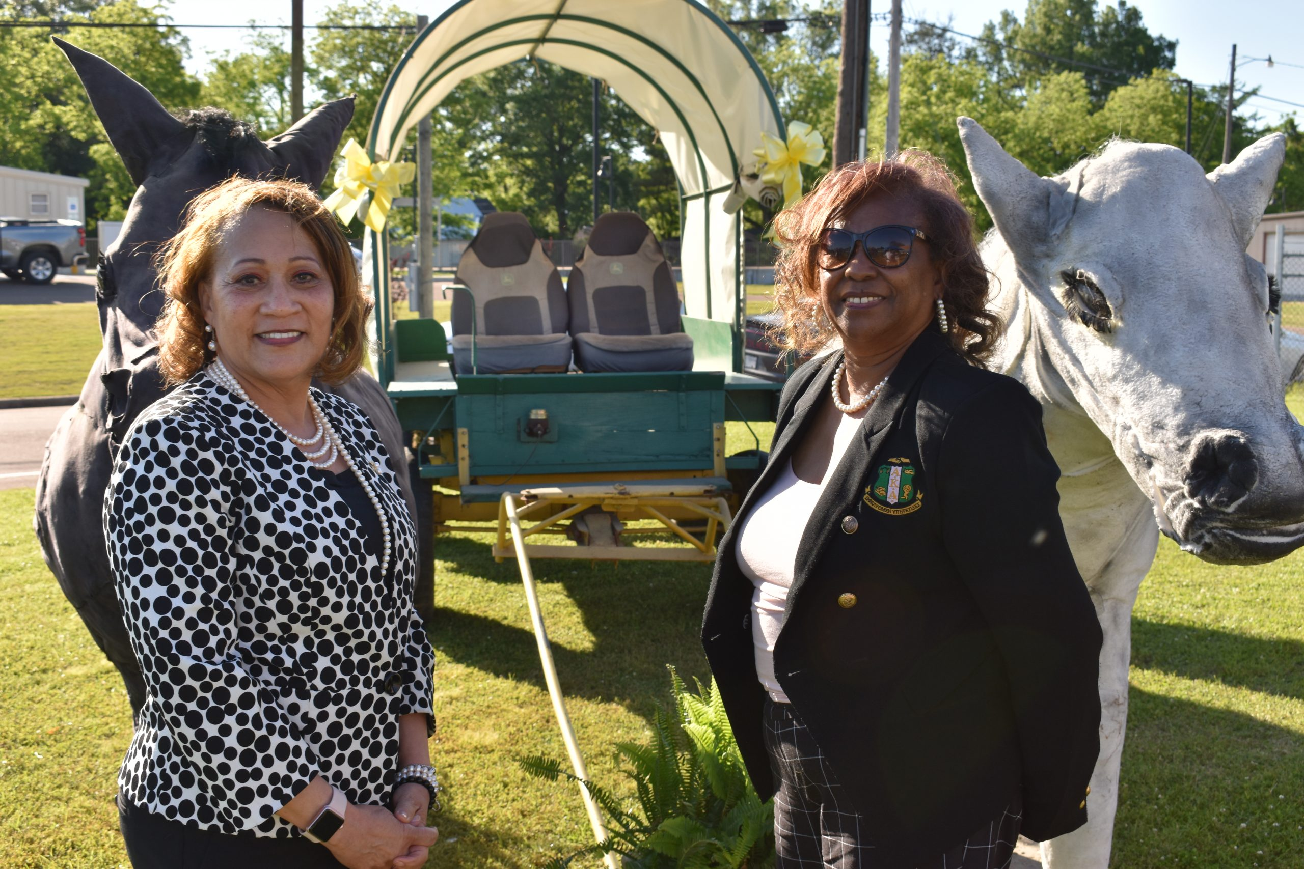 Photo of two women in front of mule wagon