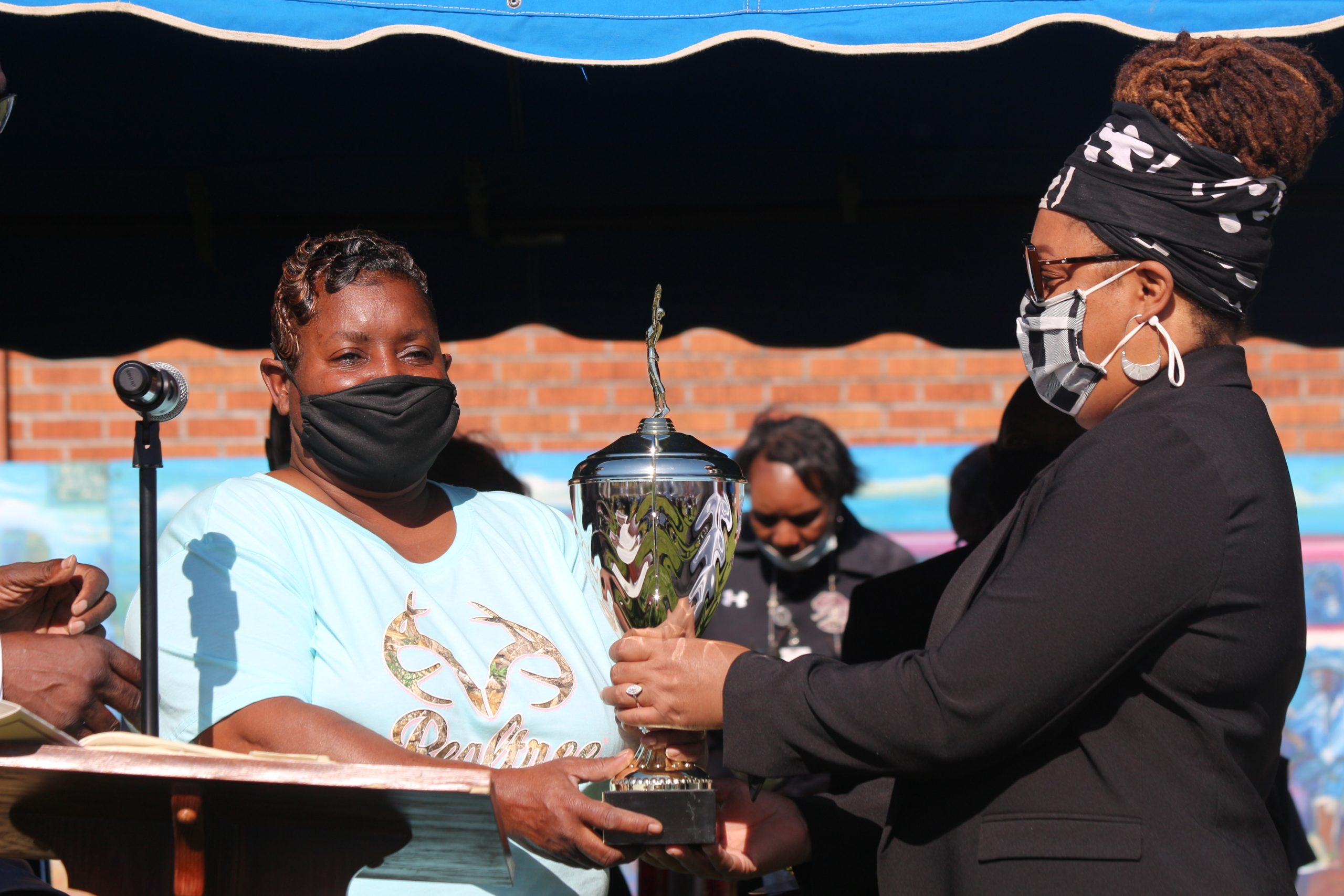 TWo women with trophy