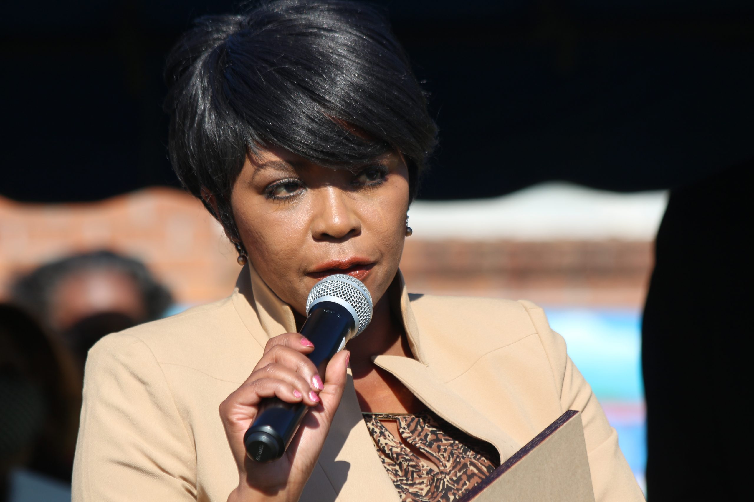 Woman Speaking over microphone